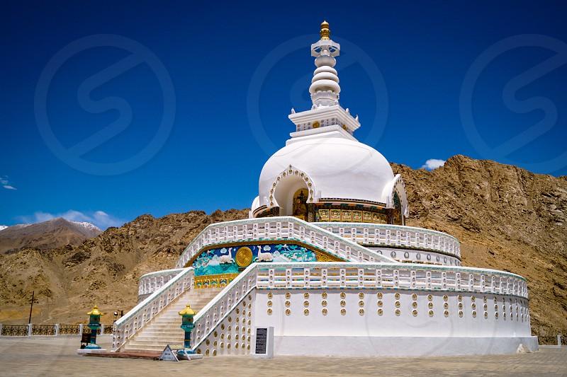 Shanti Stupais aBuddhistwhite-domedstupa(chorten) on a hilltop in Chanspa photo