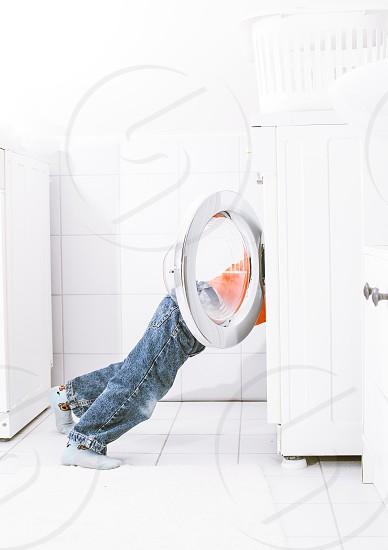 boy child play washing machine bathroom lifestyle photo