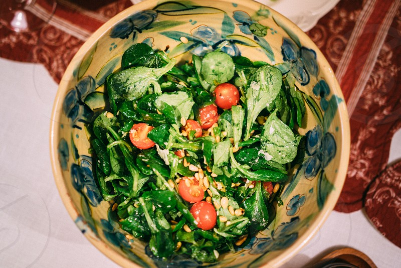 Fresh salad with cherry tomatoes pine nuts corn salad spinach photo