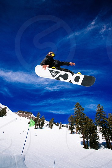 Snowboarding jumping flying sky resort trees  photo