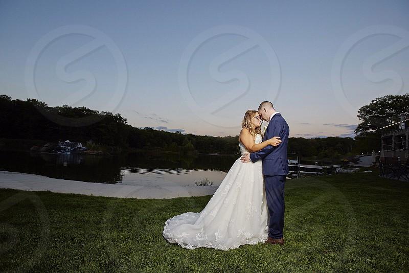 Wedding bride and groom sunset beautiful background  photo