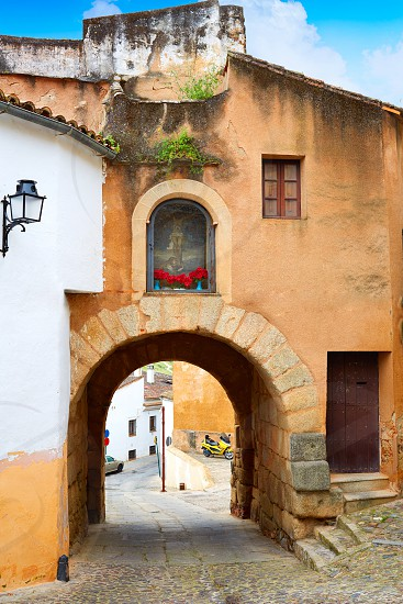 River door Arco del Cristo in Caceres of Spain at Extremadura photo
