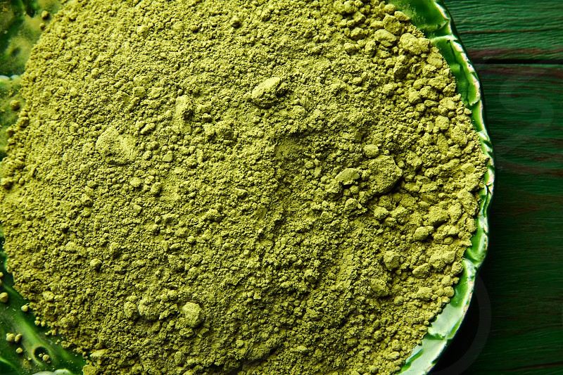 Matcha tea powder for japanese ceremony on green plate table photo
