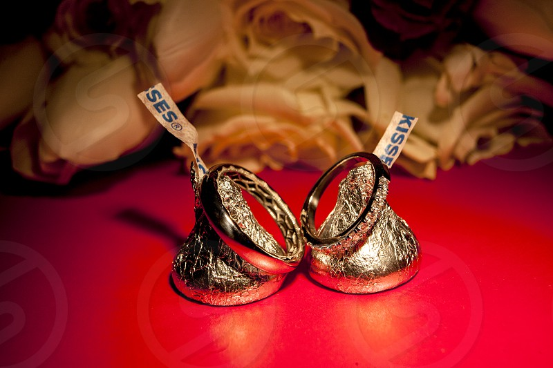 Kisses candy showing love at a wedding with wedding rings.  photo