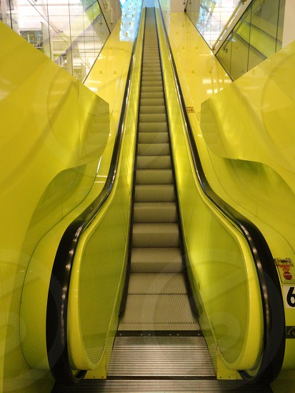 Yellow escalator inside the Seattle Library. photo