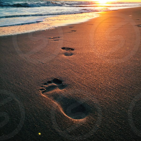 foot prints on seashore photo