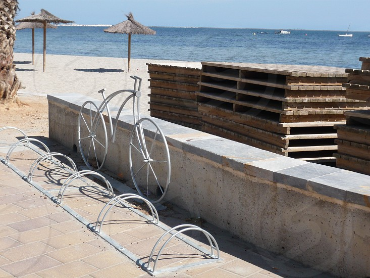 Bicycle standing promenade by beach in Spain photo