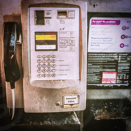 low light photography of telephone booth photo