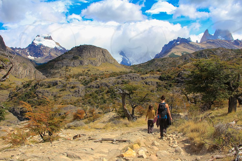 Young women hiking on the Laguna Torre Trail near El Chalten Patagonia Argentina photo
