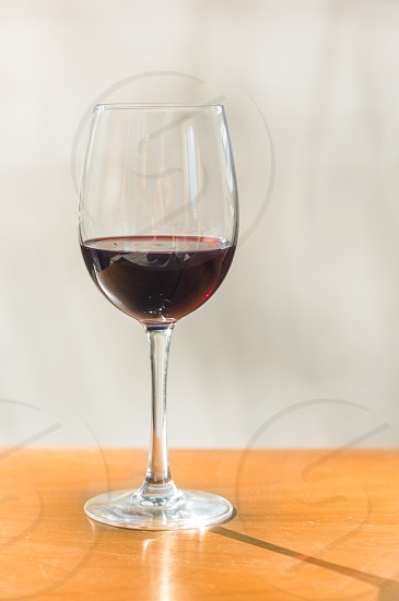 indoor shot of glass of wine with red wine photo