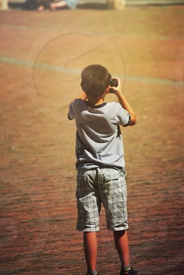 child taking photos photo