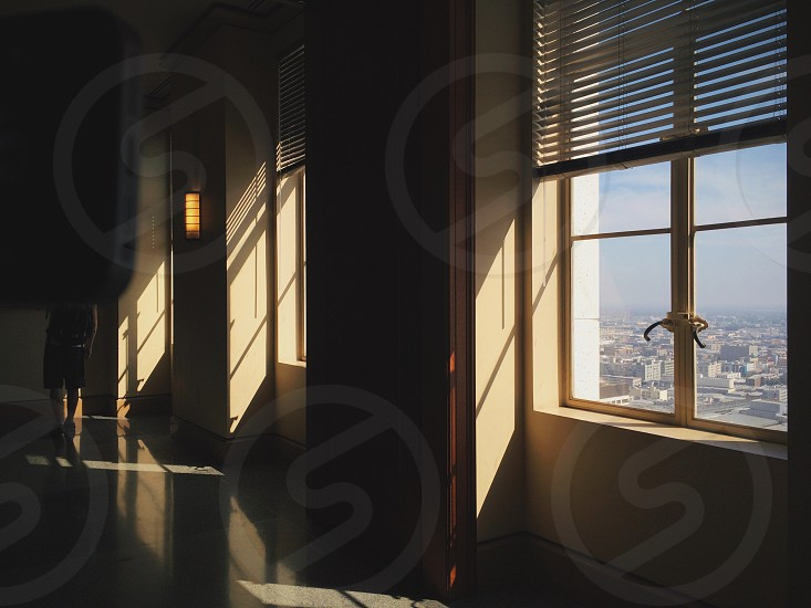 closed windows with louvers halfway cover photo