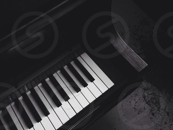 black stand up piano photo