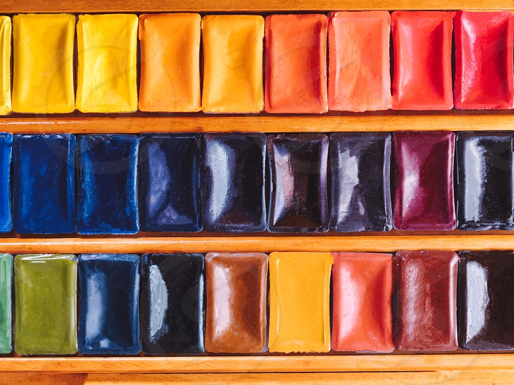 Set of watercolor paints in wooden box. photo