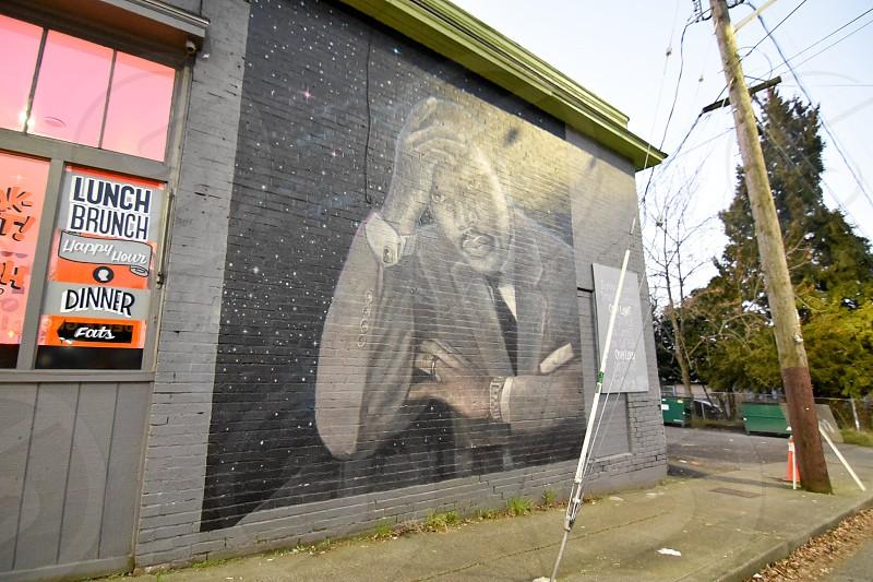 man in formal suit jacket graffiti photo