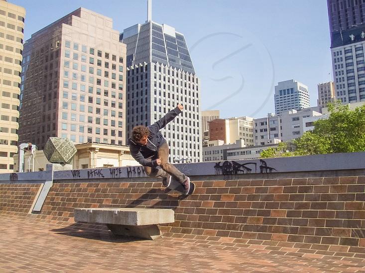 Skateboarder riding a wall in San Francisco California photo