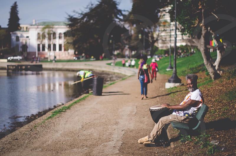 man sitting on bench photo