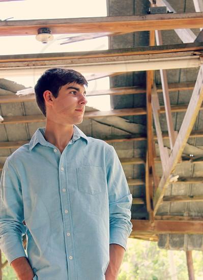 man wearing blue long sleeve button down collared shirt photo