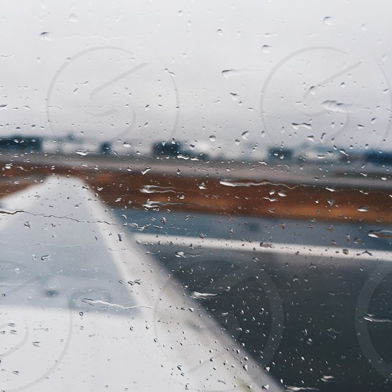 clear glass window with water drops photo