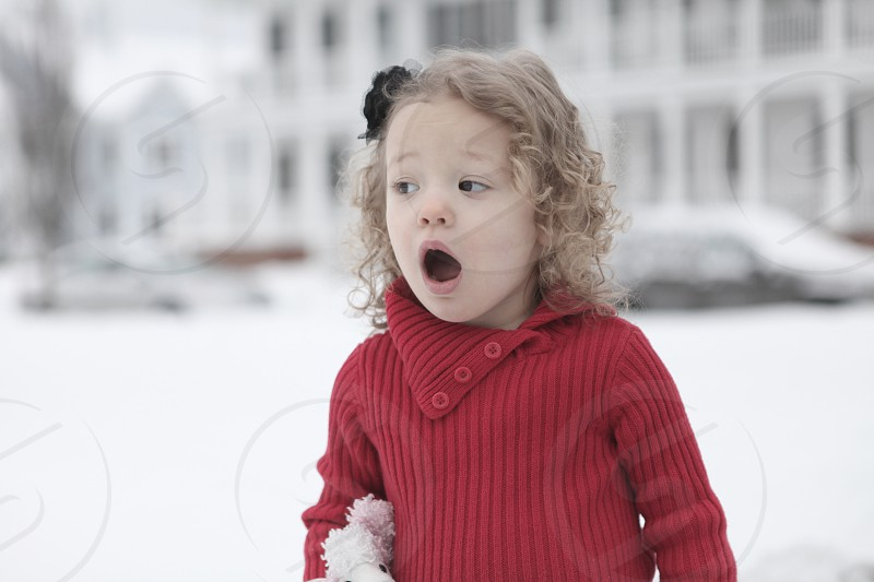 toddler wearing red winter sweatshirt photo