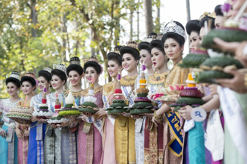 traditional dresst thai people at the Loy Krathong Festival in the Historical Park in Sukhothai in the Provinz Sukhothai in Thailand.   Thailand Sukhothai November 2018 photo