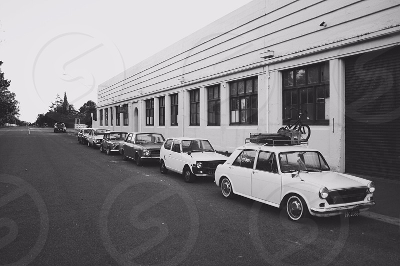 white cars parked along side building photo