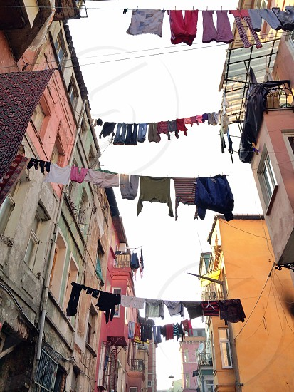 Out to dry - looking up view of this organized chaos from the streets of Istanbul Turkey. photo