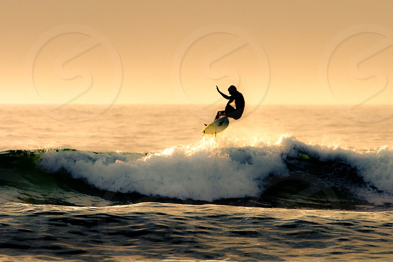 Surfer at sunset photo