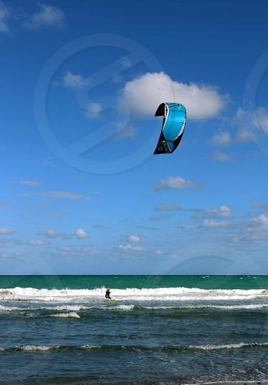 Kite boarding wind surfing surfing water sport water sports adventure fun athletic photo