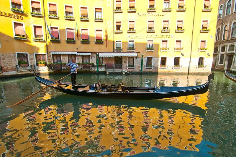 Venice Italy gondolas on canal at parking spot photo