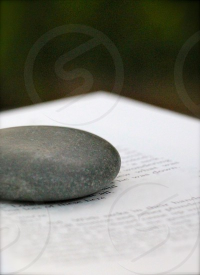 black stone on white book page in selective focus photograph photo