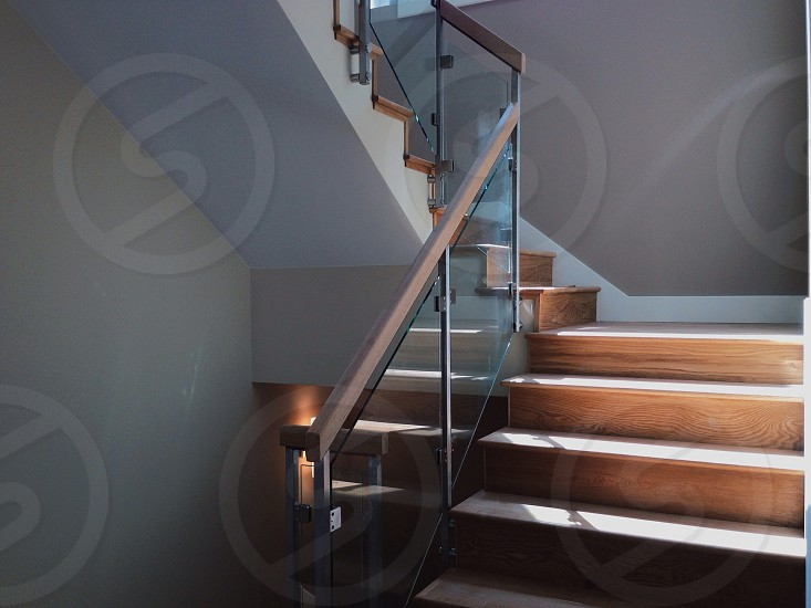 staircase with clear glass side photo