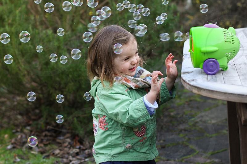 Baby garden winter toddler child fun bubbles photo