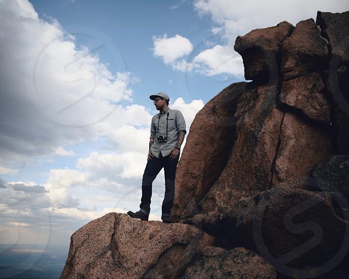 Photographer standing on rocks.  photo