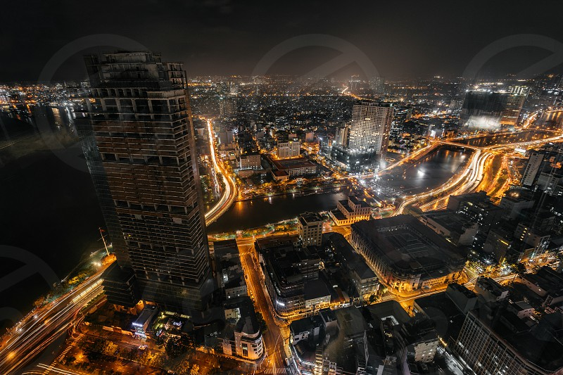 Night cityscape of Ho Chi Minh City from the high of Bitexco tower. Traffic trails on street. photo