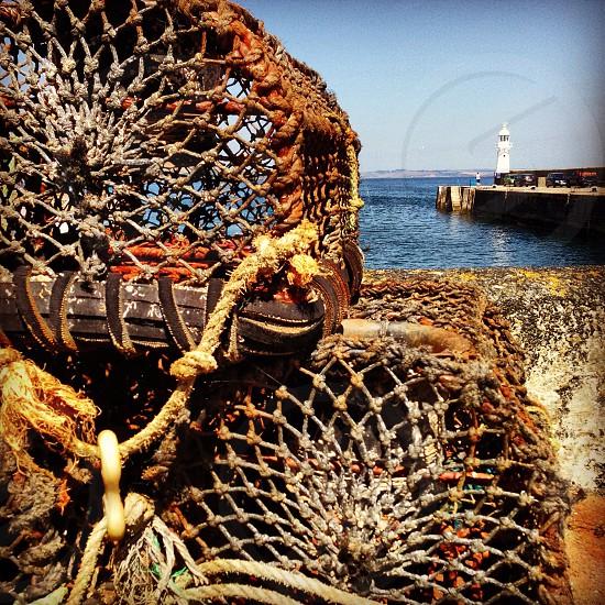 Light house framed by lobster pots  photo