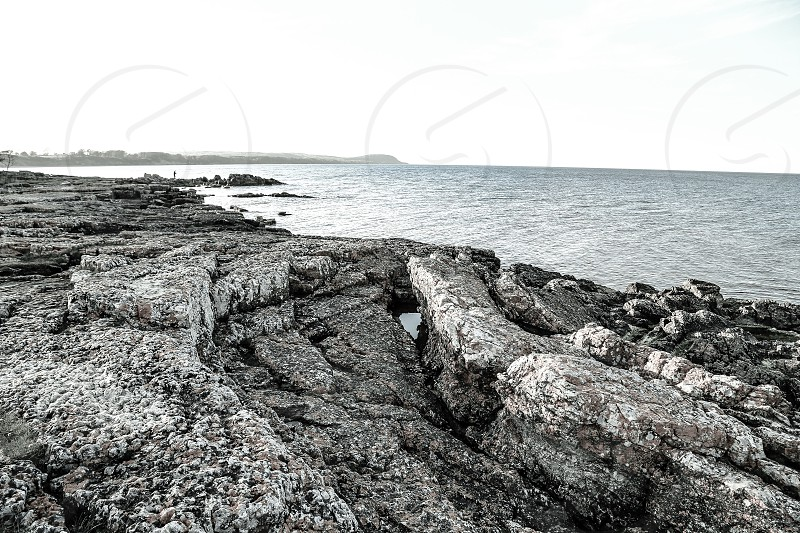 Monochrome and muted tones of a beautiful landscape scene of a piece of the Swedish coast photo
