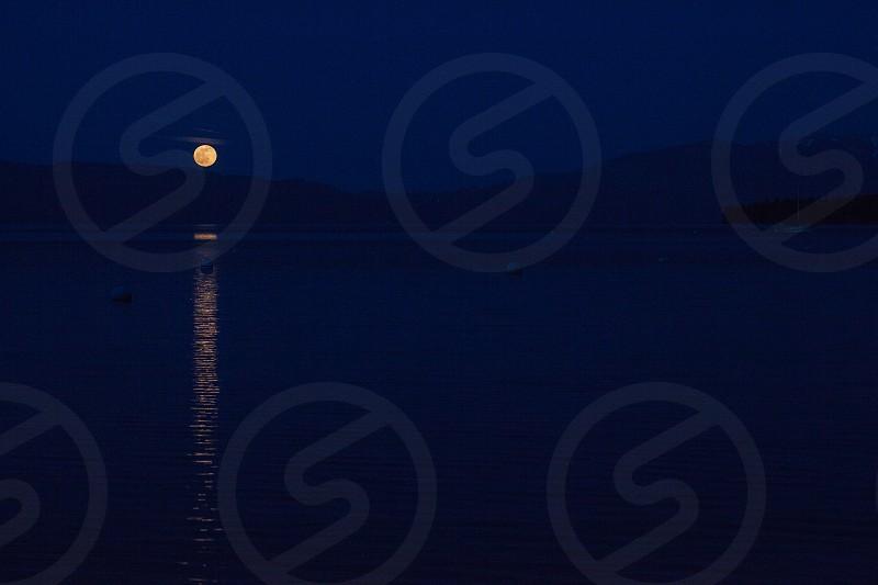 Lake Tahoe full moon reflection rising photo