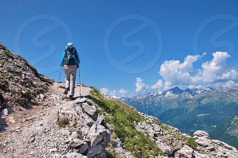 Low angle view of mature woman hiking in Brenta Dolomites in Italy photo
