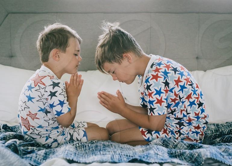 Praying prayer boys children bedtime prayers religion photo