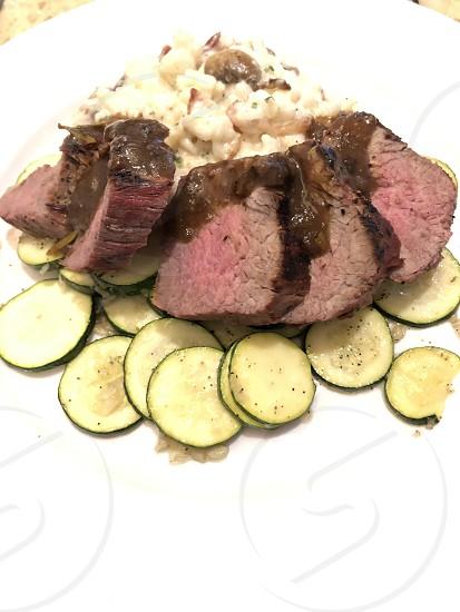 Steak potatoes zucchini dinner  photo