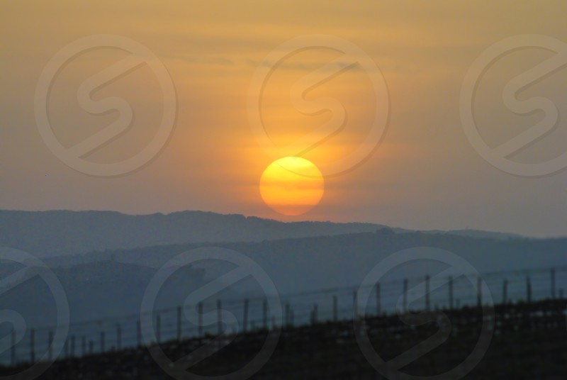 cloudy sunset in italian countryside photo