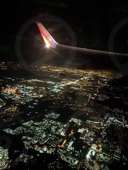 airplane nighttime city flying night lights travel photo