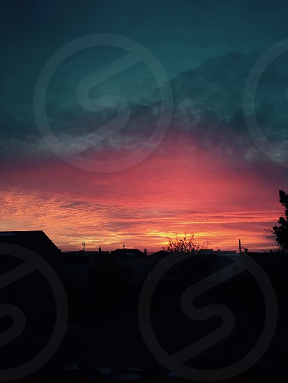 Sunsets backyard looking west California west coast red orange yellow gray outlines photo