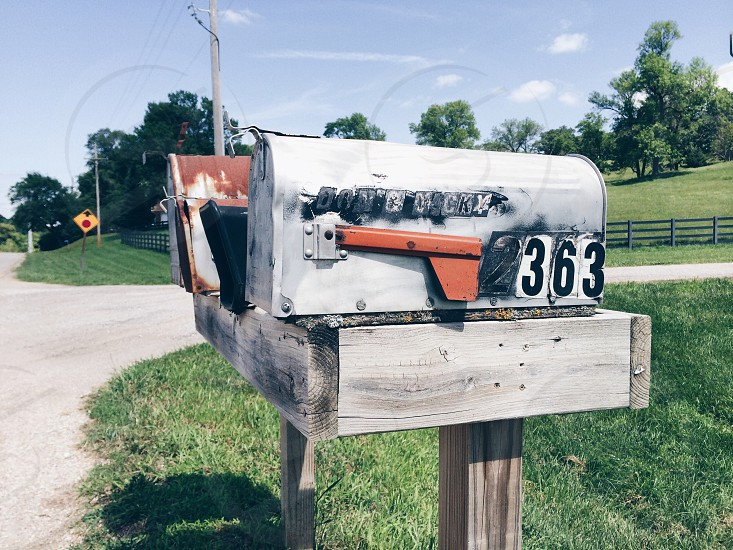 gray and brown 363 mailbox during daytime photo