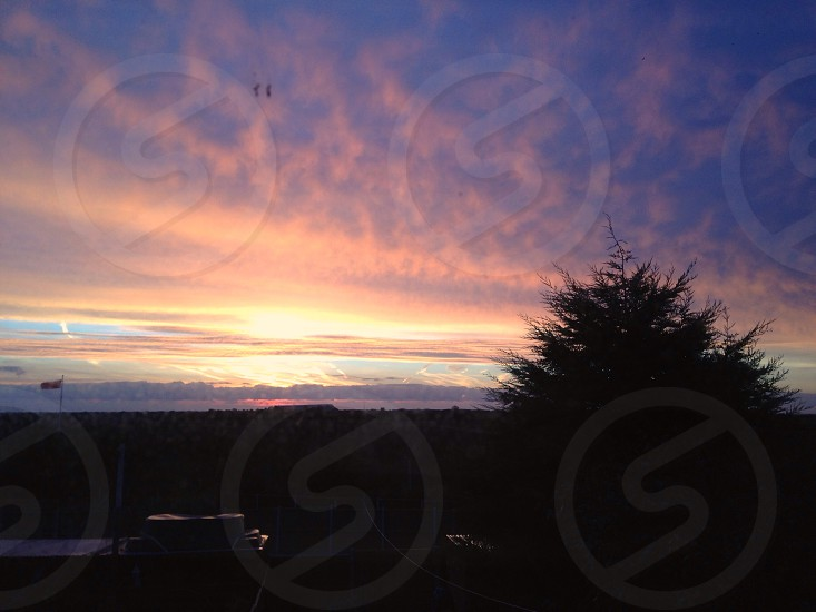 The sunrise from my bedroom window.  photo