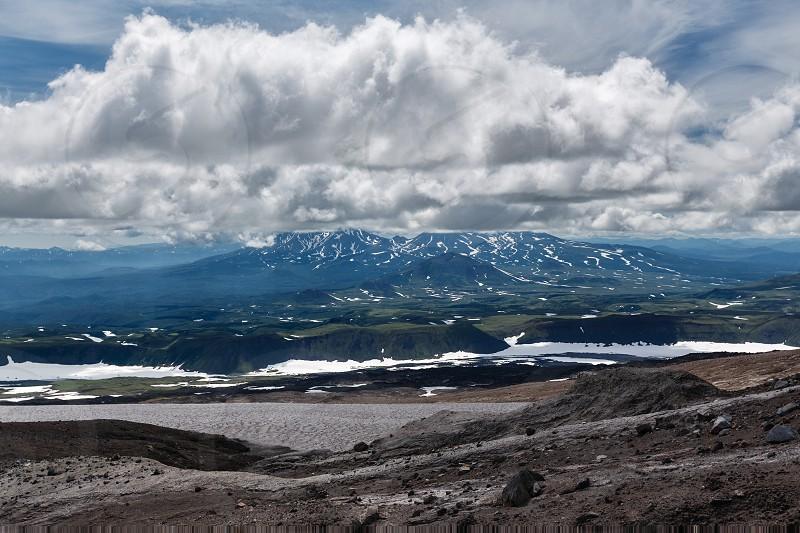 Beautiful mountain (volcanic) cloudy landscape of Kamchatka Peninsula (Russia Far East). photo