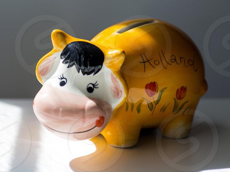 yellow and white cow holland ceramic piggy bank photo