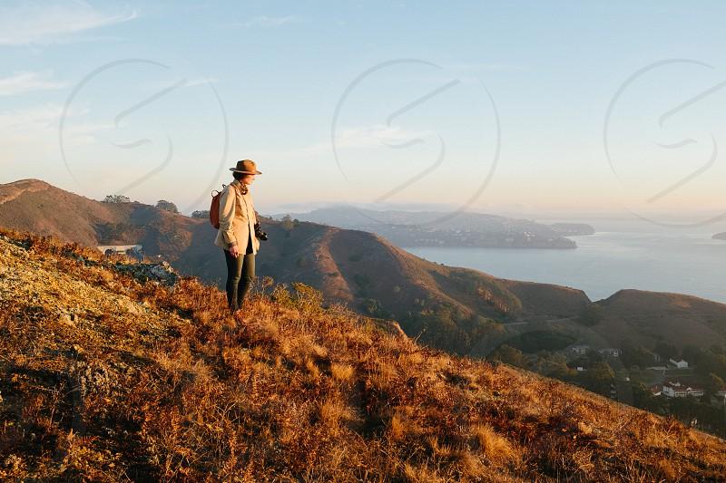 human on the summit mountain photo