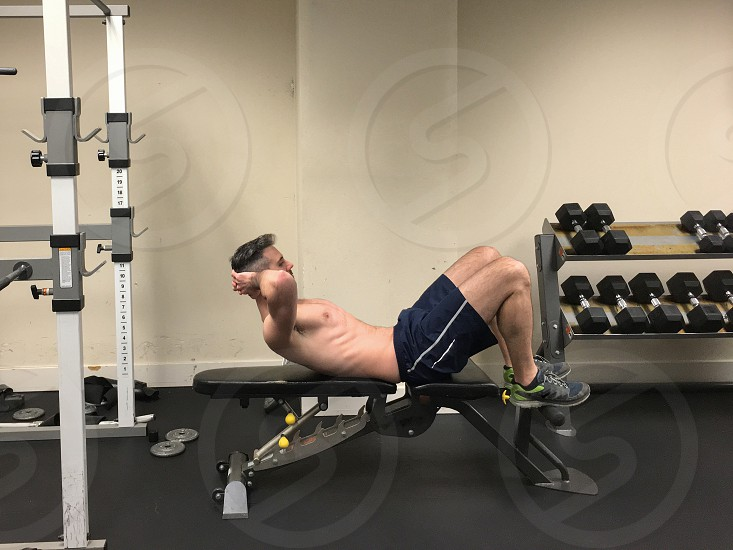Man doing various exercises in the gym photo